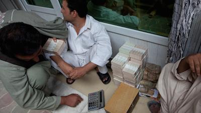 Stacks of cash sit opening in teh Hawala market