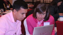 WDI case writing consultant Andrea Meyer, right, helps a professor with his business case at an April 2015 workshop in Manila.