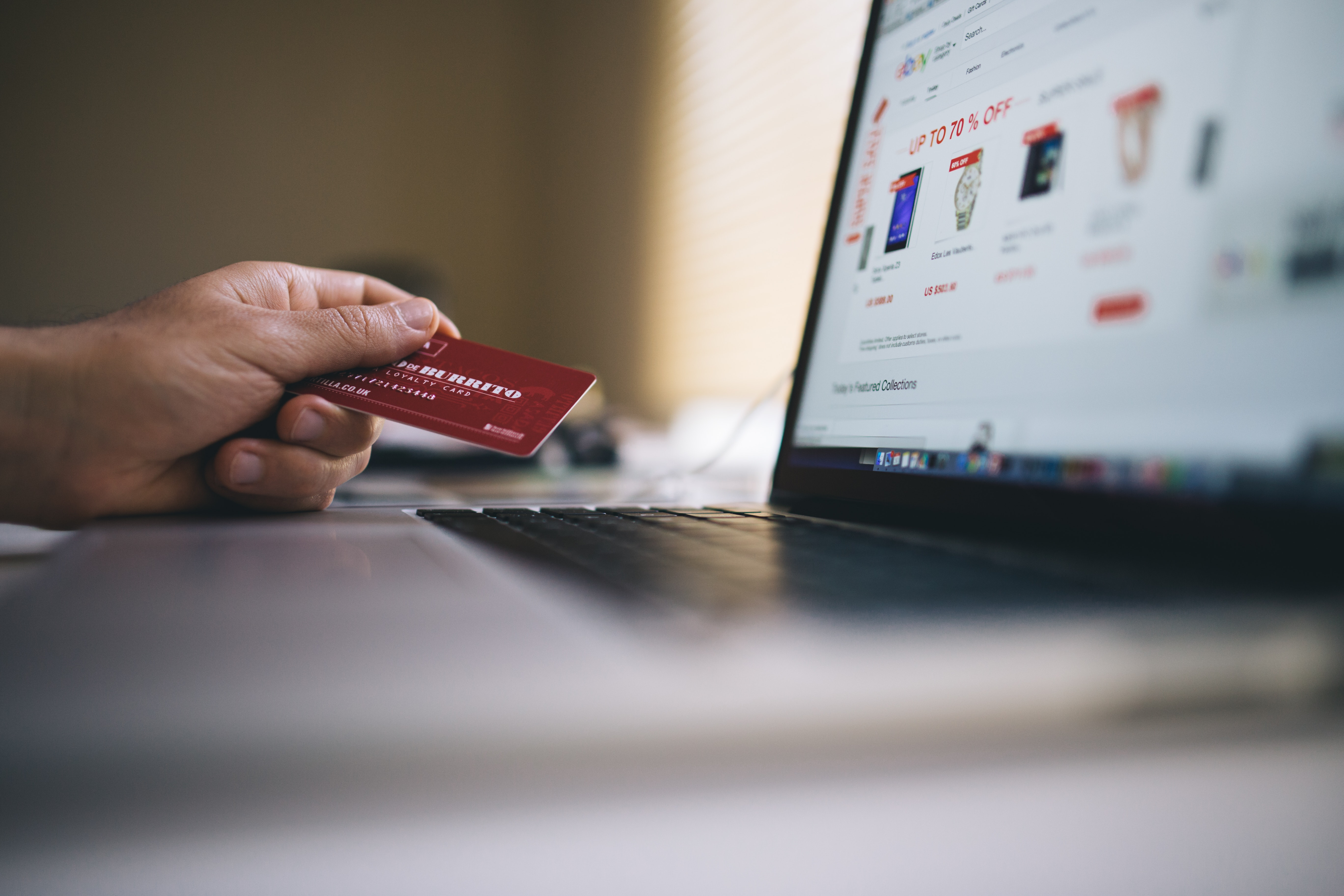 Someone holding a credit card and shopping online