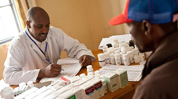 Doctor consults with patient in Africa