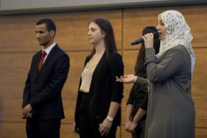 Hela Zargouni (right) pitches her team's business to judges at the M²GATE final business pitch competition at the University of Michigan's Ross School of Business. Hela was one of 11 participants from MENA to travel to Michigan.