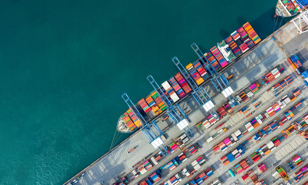 Aerial view container ship in port at container terminal port.