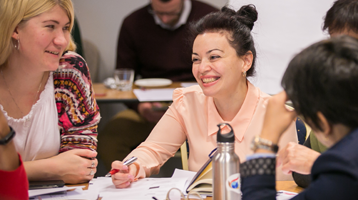Woman smiling at professional education workshop
